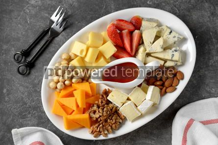 Food & Drink: Various types of cheeses with olives nuts fruits and honey Appetizer for a wine party #14381