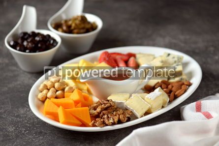 Food & Drink: Various types of cheeses with olives nuts fruits and honey Appetizer for a wine party #14382
