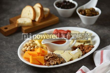 Food & Drink: Various types of cheeses with olives nuts fruits and honey Appetizer for a wine party #14383