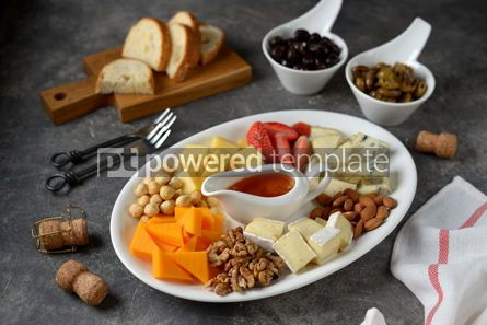 Food & Drink: Various types of cheeses with olives nuts fruits and honey Appetizer for a wine party #14385