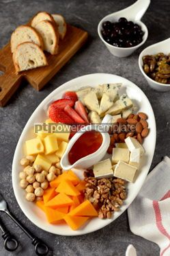 Food & Drink: Various types of cheeses with olives nuts fruits and honey Appetizer for a wine party #14387
