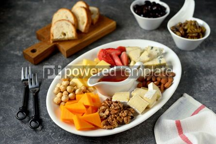 Food & Drink: Various types of cheeses with olives nuts fruits and honey Appetizer for a wine party #14388