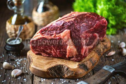 Food & Drink: Fresh raw rib eye steak on a wooden board Organic food #14397