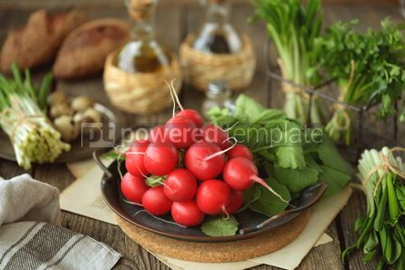 Food & Drink: Fresh spring radish with wild garlic parsley and quail eggs on a wooden background #14458