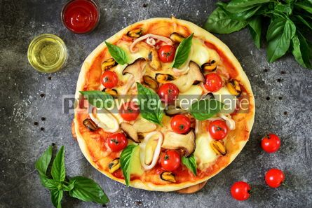 Food & Drink: Homemade pizza with mussels squids mozzarella cherry tomatoes and mushrooms #14582
