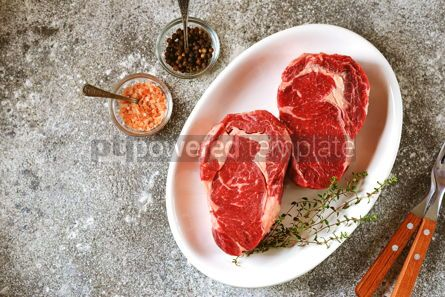 Food & Drink: Juicy raw steak with thyme on a gray background Organic healthy food Top view #14880