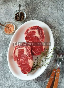 Food & Drink: Juicy raw steak with thyme on a gray background Organic healthy food Top view #14881