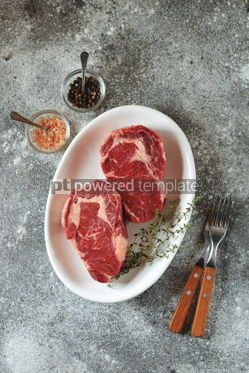 Food & Drink: Juicy raw steak with thyme on a gray background Organic healthy food Top view #14882