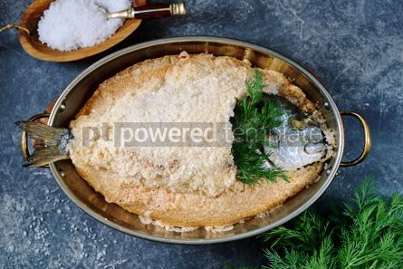 Food & Drink: Sea fish dorado fish baked in coarse salt mixed with egg white Healthy food Top view #14883