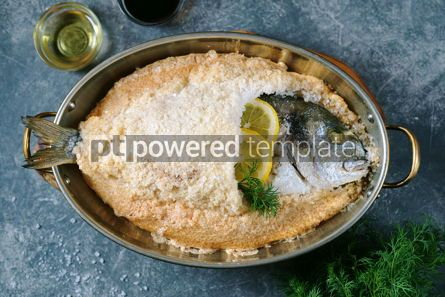 Food & Drink: Sea fish dorado fish baked in coarse salt mixed with egg white Healthy food Top view #14886