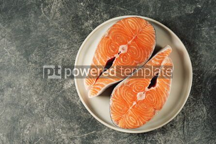 Food & Drink: Two fresh raw salmon steaks on a gray concrete background Healthy food Top view Copy space #14964