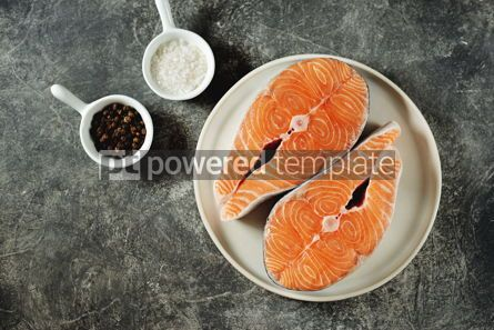 Food & Drink: Two fresh raw salmon steaks on a gray concrete background Healthy food Top view Copy space #14965