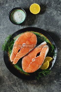 Food & Drink: Two fresh raw salmon steaks on a gray concrete background Healthy food Top view #14967