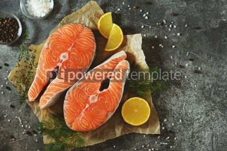 Food & Drink: Two fresh raw salmon steaks on a gray concrete background Healthy food Top view Copy space #14973
