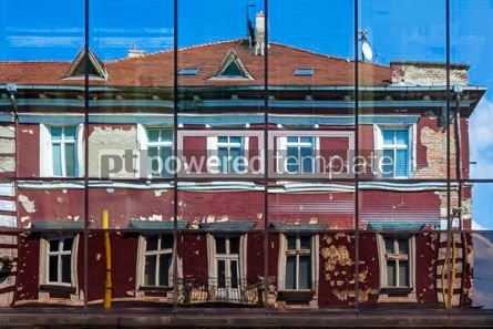 Architecture : Facade of old building reflected in the windows of modern Hotel #15697