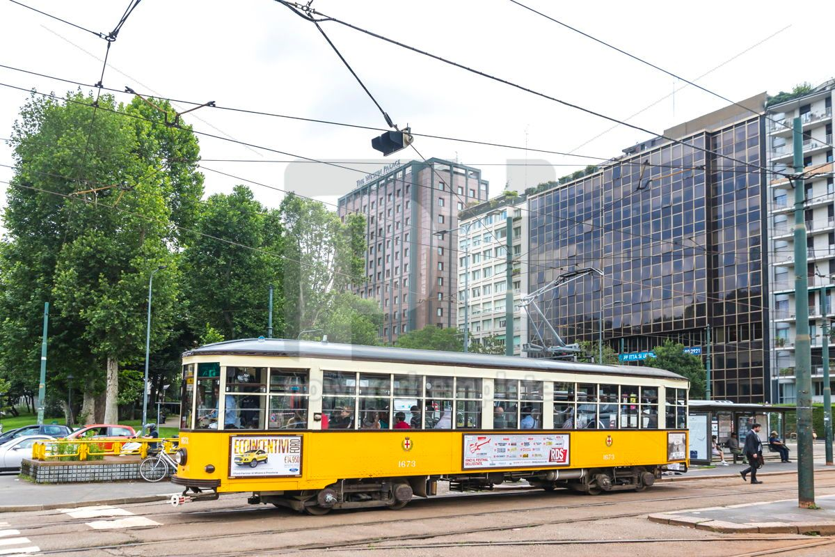 Vintage yellow tram on the street in of Milan Italy, 15873, Transportation — PoweredTemplate.com