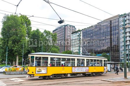 Transportation: Vintage yellow tram on the street in of Milan Italy #15873