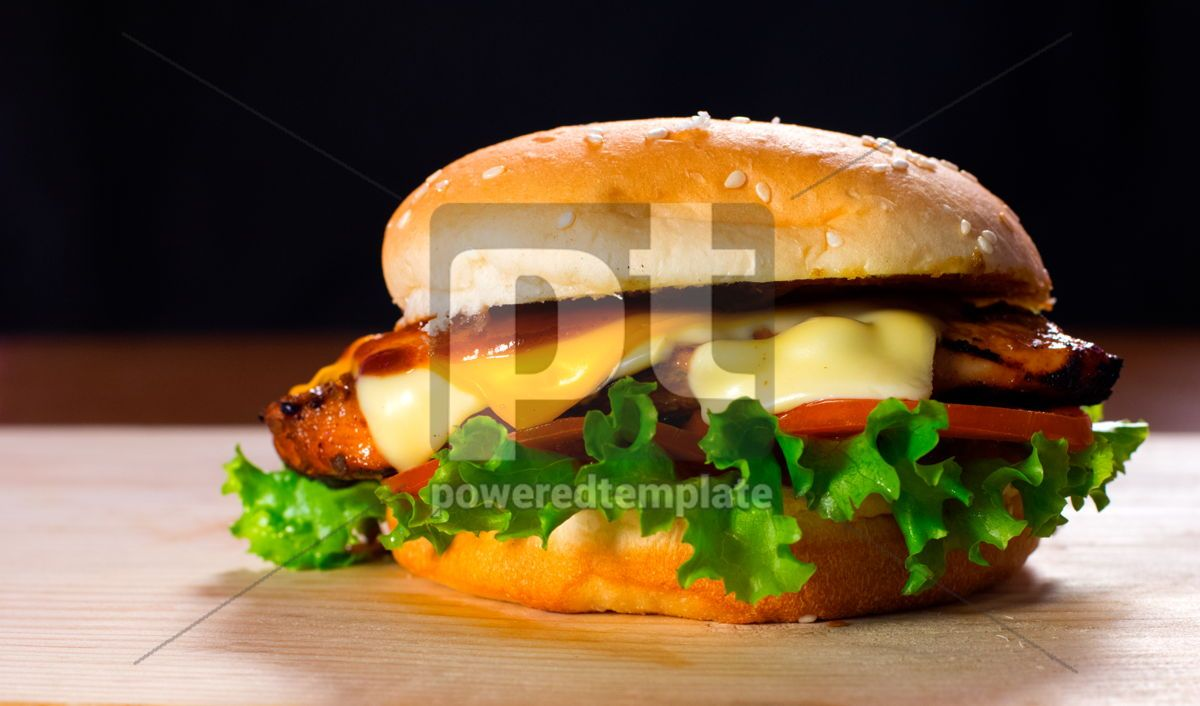 Fresh and Juicy Burger on a Wooden Table with Cheese Lettuce and Tomato, 15890, Food & Drink — PoweredTemplate.com