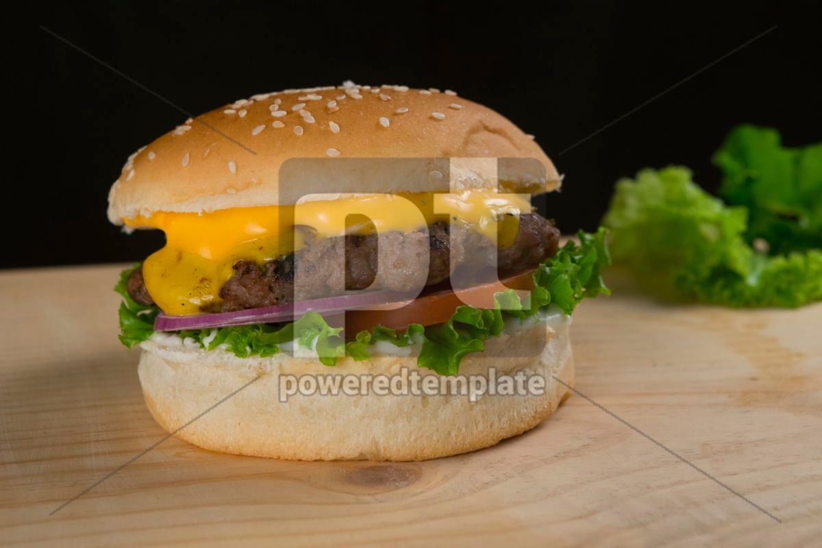 Delicious Beef Burger With Lettuce Tomato Onion Cheese on Wooden Table and Dark Background, 15892, Food & Drink — PoweredTemplate.com
