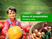 Agriculture: Kid with Pumpkin PowerPoint Template #01009