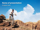 Sports: Mountain Biking In Rocks PowerPoint Template #01849