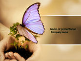 Nature & Environment: Butterfly In Your Hands PowerPoint Template #04567