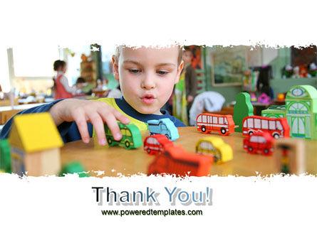 Kid Playing In Kindergarten PowerPoint Template Slide 20