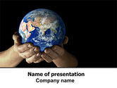 Globe In Children's Hands PowerPoint Template#1
