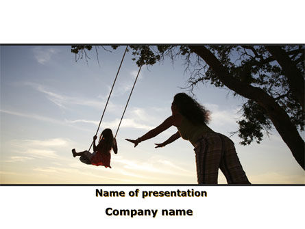 Religious/Spiritual: Mother Swings Her Daughter On A Swing PowerPoint Template #09691