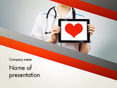 Medical: Doctor Holding a Tablet PC with Heart PowerPoint Template #12994