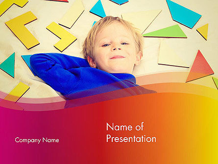 Boy with Tangram Puzzles PowerPoint Template