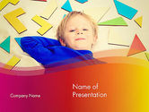 Boy with Tangram Puzzles PowerPoint Template#1