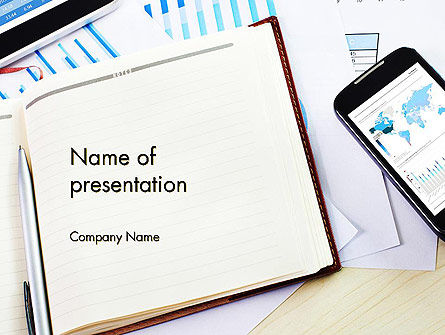 Business: Table with Notebook Smartphone and Reports PowerPoint Template #14252