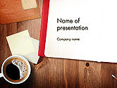 Open Notebook with Cup of Coffee on Wooden Desk PowerPoint Template#1