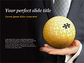 Business Concepts: Business Man Hold a Puzzle Globe PowerPoint Template #14872