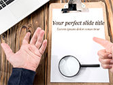 Business Concepts: Notebook with Magnifying Glass on Wooden Workplace PowerPoint Template #14995