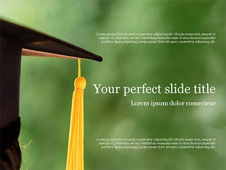 University Graduate Wears Black Cap with Yellow Tassel PowerPoint Template, 15561, Education & Training — PoweredTemplate.com