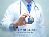 Medical: Doctor Holding World Globe PowerPoint Template #15591