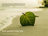 Nature & Environment: Leaf in Sand on the Beach PowerPoint Template #15672