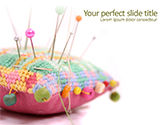 Art & Entertainment: Handmade Pin Cushion with Multicolored Sewing Pins PowerPoint Template #15692