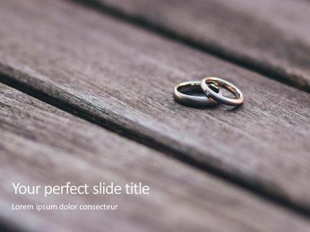 Holiday/Special Occasion: Two Wedding Rings on Wooden Surface Presentation #16674